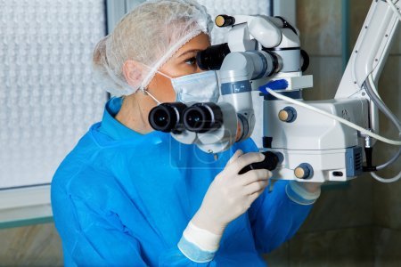 female surgeon doctor performing laser eye vision correction ope