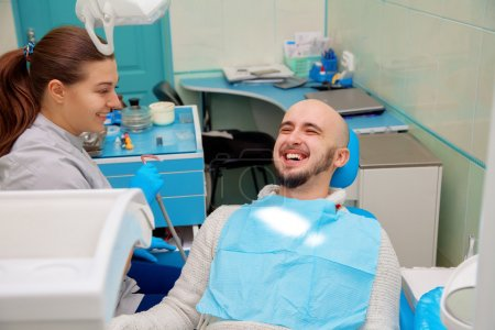 Dentist having fun with patient during treatment
