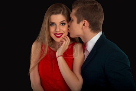 Man is kissing a woman