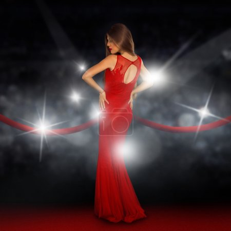 Photo for Sexual young lady on red carpet is posing in paparazzi flashes - Royalty Free Image