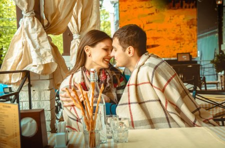 Photo for Portrait of lovely young couple in love having fun on a date in restaurant - Royalty Free Image