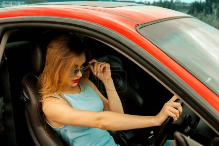 glamour young girl driving sport car