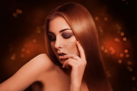 Attractive sensual brown hair woman with closed eyes in studio