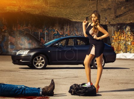 Blonde luxury woman stand over bag full of money amin fuming car