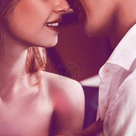Square photo of couple kissing each others. without eyes only li