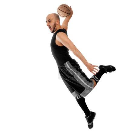 Basketballer makes a slam dunk on white background
