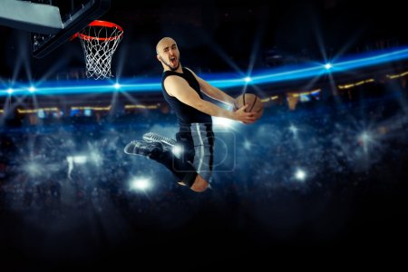 Horizontal photo of basketball player in the game makes reverse
