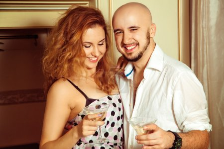 Cute young couple at martini home party