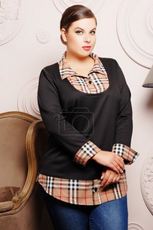 Plus size woman in trendy clothes
