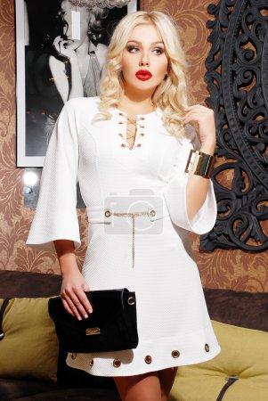 blond woman in stylish dress