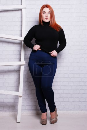 Pretty plus size woman in casual clothes