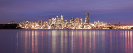 Photo for Night falls showing reflections in the smooth water of Elliott Bay - Royalty Free Image