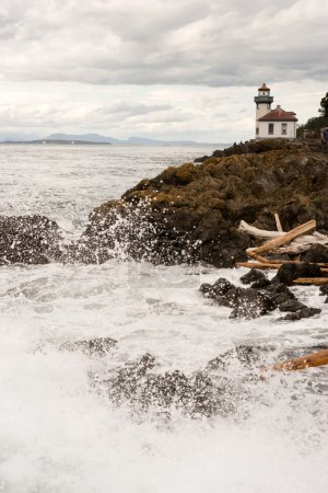 Waves Crash onto Sharp Rocks Jetty San Juan Island Lighthouse