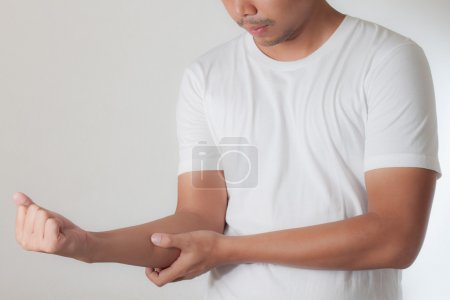 man having arm with muscle pain.