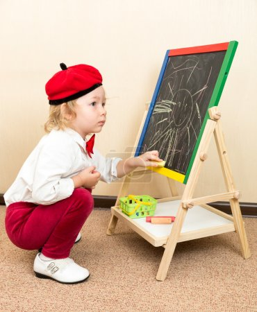 Girl drawing with chalks