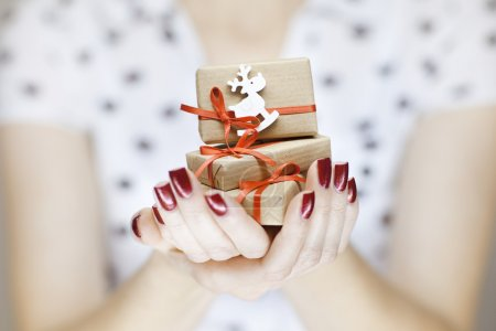 Beautiful woman hands holding christmas decorations