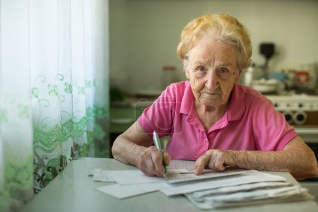 Woman fills out utility bills