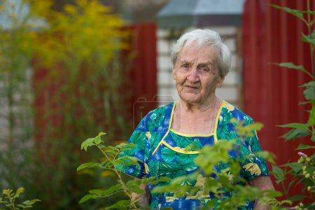 Elderly woman standing outdoor