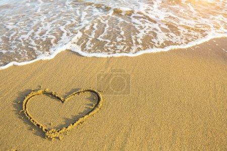 Hand drawn heart on beach
