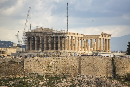 Photo for ATHENS, GREECE - APR 7, 2015: Parthenon temple on the Acropolis hill. Parthenon is a former temple on the Athenian Acropolis, dedicated to the goddess Athena. Construction began in 447 BC. - Royalty Free Image