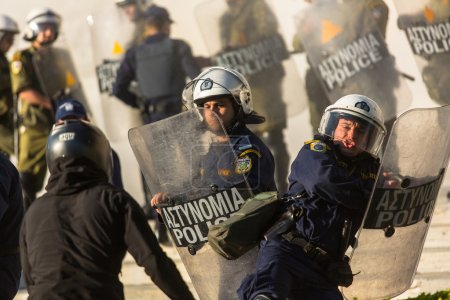 Riot police with their shields