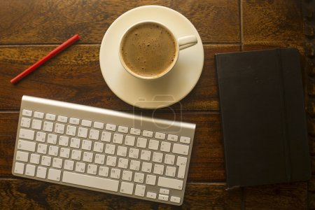 keyboard, pencil, notepad and cup of coffee