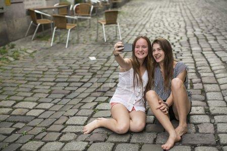 Two teenage girls doing selfie