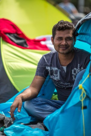 Unidentified refugee near tents