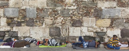 Refugees sleeping on the ground