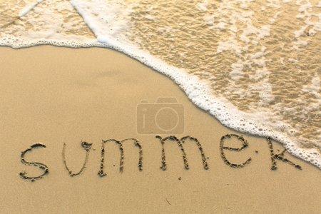 SUMMER written on beach sand