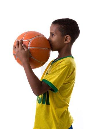 boy fan holding basketball ball