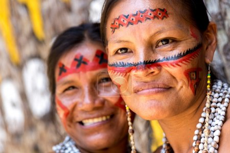 Brazilian women smiling at tribe