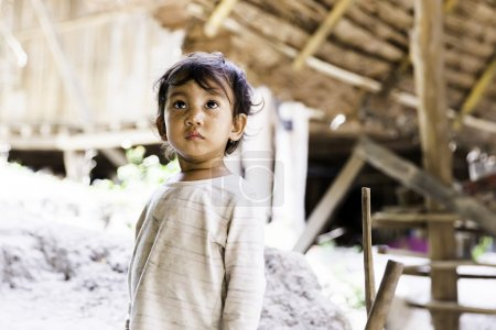 Children posing for a picture at Karen Long Neck Village in Chiang Mai, Thailand.