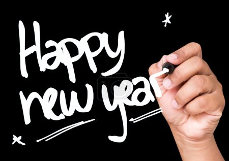 Happy new year written on a transparent board