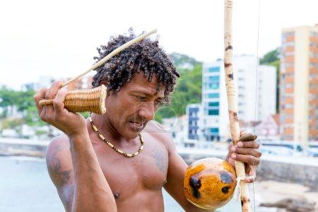 Brazilian playing Berimbau Instrument in Salvador, Bahia, Brazil.