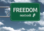 Freedom, next exit creative road sign