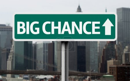 Big Chance road sign and a business city