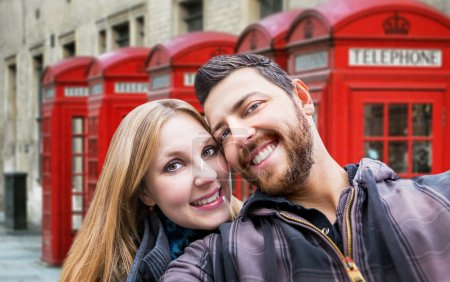 Beautiful Couple taking a selfie photo in London, England