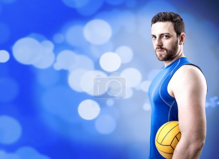 Volleyball player on blue uniform on blue bokeh background