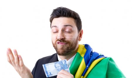 Brazilian not so happy holding Brazilian money and the flag