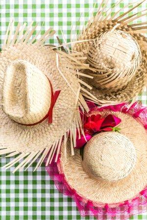 Brazilian traditional Straw Hats on the table (Festa Junina Theme)