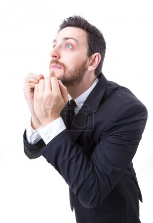 Businessman praying on white background