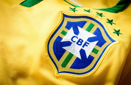 "The logo of the soccer organization ""CBF Brasil"" on an official jersey."