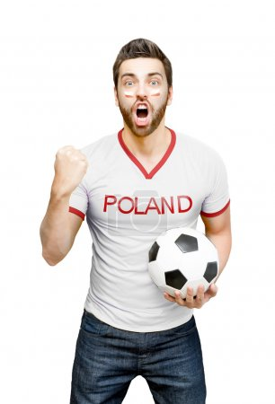 Polish fan holding a soccer ball celebrates on white background
