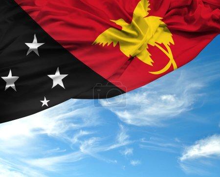 Papua New Guinea waving flag on a beautiful day