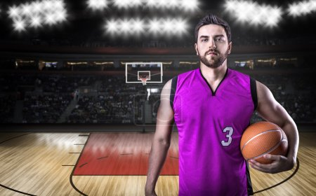 Basketball Player on a purple uniform in basketball court