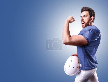 Football Player on blue uniform on blue background