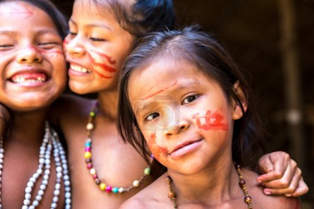Native Brazilians girl smiling at an indigenous tribe in the Amazon