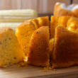 Corn cake sliced on wooden board on rustic wooden ...