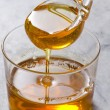 Agave Syrup pouring on a glass. Alternative sweete...